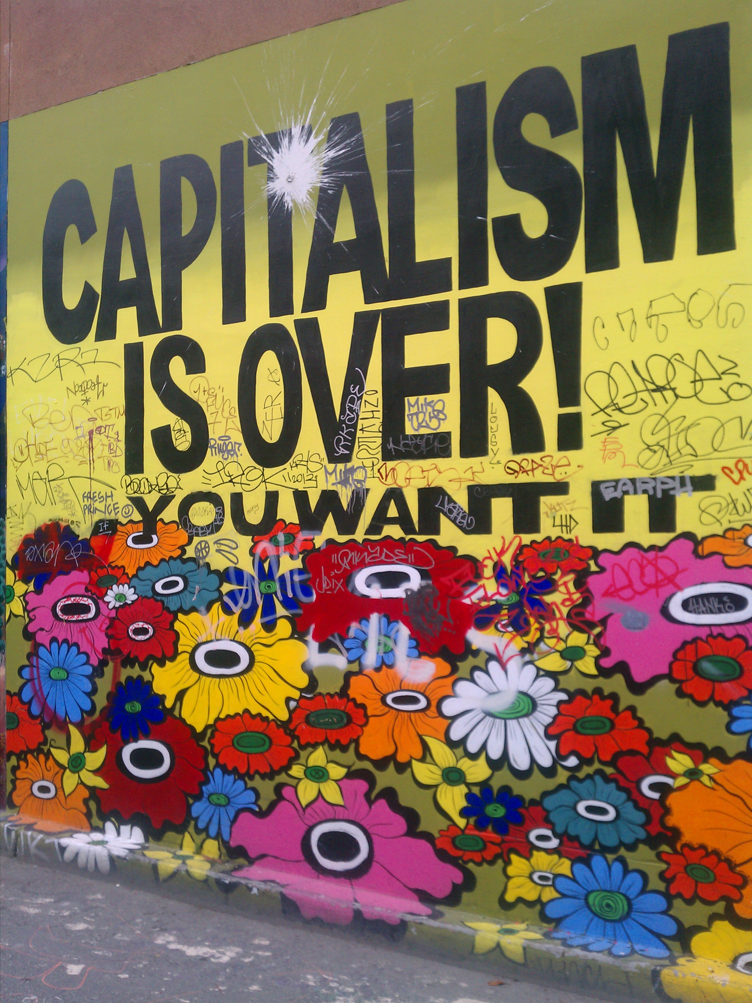 Mural which reads capitalism is over.